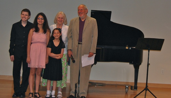 "On Sunday, June 8, 2014, at LICA's 43rd Anniversary concert held at the South Huntington Public Library, the three students chosen as winners of the Arline Diamond Memorial Award are honored. The student composers were selected as Award Winners at the ""Music By and For Students"" concert held on May 23 at Hofstra University. Part of that annual award is performance at the LICA Anniversary Concert. The 2014 winners are Scott Etan Feiner, Elizabeth Gergel and Hannah Kosek. With them are LICA President Herbert Deutsch and Vice President Marga Richter."